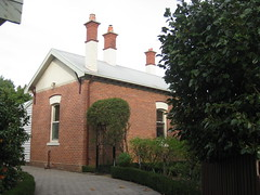 The Rear of the Former Presbyterian Manse - Colac (raaen99) Tags: door city trees windows chimney house building brick home stone architecture garden iron architecturaldetail queenanne lawn australia stainedglass victoria artnouveau villa 1912 verandah nouveau 1910s residence housename 20thcentury shrubs frontdoor stainedglasswindow edwardian gable colac shrubbery corrugatediron 1900s redbrick manse jugendstil artsandcraftsmovement artsandcrafts fretwork countryvictoria vicarage artscrafts presbytery latticework westerndistrict belleepoque domesticarchitecture twentiethcentury bellepoque oldmanse theoldmanse roughcast queenannestyle artscraftsmovement brickandstone queenannearchitecture queenannebuilding edwardiana provincialvictoria federationqueenanne federationqueenannearchitecture presbyterianmanse artnouveaustainedglass artnouveaufretwork artnouveaustainedglasswindow federationqueenannestyle federationqueenannebuilding pollackstreet pollackst corangamitest corangamitestreet