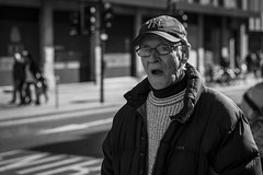 Gasping (Leanne Boulton) Tags: monochrome portrait people urban street candid portraiture streetphotography candidstreetphotography candidportrait streetportrait streetlife man male old elderly age look emotion feeling face facial expression mouth gasping agape cap tone texture detail depthoffield bokeh naturallight outdoor light shade shadow city scene human life living humanity society culture canon canon5d 5dmkiii 70mm character ef2470mmf28liiusm black white blackwhite bw mono blackandwhite glasgow scotland uk