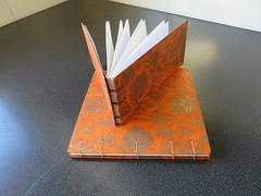 Two coptic bound (Kalmagic !) Tags: book binding bookbinding orange indian craft paper copti bound handmade journal coptic