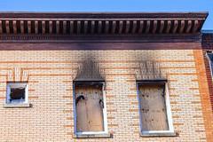 Smoked Windows (BFrue) Tags: fire windows building smoked smoke abandoned bricks broken urban urbanex street architecture old burnt out burned facade molding decorative charred damage soot