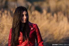 Red and gold (The Whisperer of the Shadows) Tags: margui portrait retrato chica girl mujer woman sunset atardecer dusk ocaso golden dorado light luz canon70200f4l face cara red rojo biker cazadora geotagged