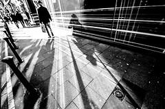 Traveling on rays of light (Hendrik Lohmann) Tags: street streetphotography strassenfotografie strase analog fujifilm bw bwstreet düsseldorf nikon light hendriklohmann