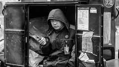 In the box (Go-tea 郭天) Tags: qingdaoshi shandongsheng chine cn canon eos 100d 50mm prime street urban city outside outdoor people bw bnw black white blackwhite blackandwhite monochrome naturallight natural light asia asian china chinese shandong man qingdao uniform worker working work business seat doors open opened rest resting break delivery delivering alone lonley mobile phone network connected trunk inside covered cold coat duty officer listing papers bags boxes box badge name tag motorbike motobike moto motocycle job portrait candide candid