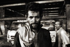 Under the tunnel, Kolkata (paola ambrosecchia) Tags: tunnel kolkata india blackandwhite monochrome street portrait face eyes light dark shadow men movement biancoenero ritratto people streetlife city