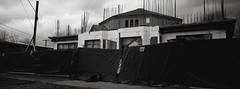 Portland (austin granger) Tags: portland construction fence rebar change tarps hidden telephonepole geometry lines film xpan wall