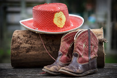 Thus, It Began (jah32) Tags: cowboy cowboyhat red boots cowboyboots childrenscowboyhat childrenscowboyboots findingmyinnercowboy bokeh stilllife childhooddreams