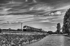 Racing the Barges (Evoljo) Tags: wiltsandberks canal crofton wiltshire gwr train water sky cloud blackwhite nikon d500
