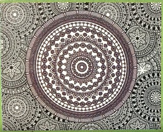 Small image of Mandala jigsaw taking several people a few days to complete