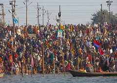 Pilgrims Bathing In Ganges, Maha Kumbh Mela, Allahabad, India (Eric Lafforgue Photography) Tags: travel people india tourism water festival river outdoors photography togetherness boat bath asia day flag religion crowd bank celebration event spirituality bathing hinduism pure pilgrimage religiouscelebration pilgrim traditionalculture sangam humaninterest allahabad socialgathering haridwar purification gangesriver yamunariver uttarpradesh realpeople kumbhmela traveldestinations colorimage indianculture uttarakhand 3557 largegroupofpeople indiansubcontinent celebrationevent traditionalceremony indianethnicity mixedagedrange