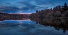 Burrator blues (snowyturner) Tags: trees lake clouds reflections evening symmetry reservoir dartmoor moorland burrator