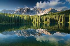 Carezza Glimpse (Noam Mai) Tags: blue italy reflection nature water clouds alpes dolomites