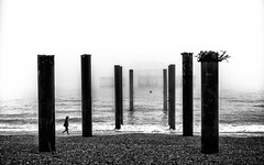 The Pale Pier (Fourteenfoottiger) Tags: seamist mist fog westpierbrighton westpier pier piers monochrome blackandwhite disappear disappearing ghostly wideangle apparition sea seaside seascape coast coastline beach pebbles abandoned ruin people figure candid streetphotography