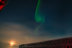 The First Aurora at South Pole (redfurwolf) Tags: southpole antarctica southpolestation aurora auroraaustralis moon fullmoon sky light clouds station polarlights polar building redfurwolf sonyalpha a99ii sal1635f28za sony outdoor exploration nature