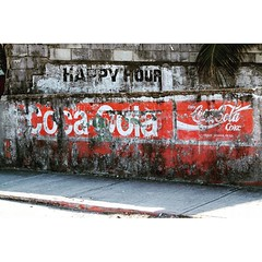 Happy Hour -- Belize City, Belize (James Patterson) Tags: happyhour streetphotography street urban urbanfragment red enjoycoke cocacola coke belizecity belize billboard sign wall