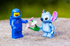 unexpected friends (jezbags) Tags: lego legos toys toy minifigure minifigures canon60d canon 60d 100mm closeup upclose spaceman stitch disney flowers friendship garden nature