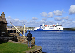 The Hamnavoe Ferry Departing Stromness (orquil) Tags: hamnavoe roro ferry prominent viking logo northlink ferries sailing departing leaving stromnessharbour scrabstercaithness destination seaside shoreline waterfront stromness town southend blue calm sea ripples seascape bluesky reflections foreground veryold private stonepiers old manualcrane oldhouse visitor photographer newpiers outskirts skyscape smallclouds sunny april afternoon spring sunshine orkney islands scotland uk unitedkingdom greatbritain orcades beautiful attractive scenic colourful memorable eyecatching interesting