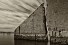 Crack in the Wall (Thomas Kloc) Tags: monmouthcounty raritanbay sandyhook clouds concretewall crackinthewall longexposure military monochrome old middletown newjersey unitedstates us