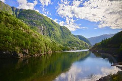 View out of the Flam Railway (SamWJL) Tags: railway flam river mountains greenery summer blue sky norway majestic nature natural