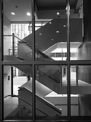 stair behind glass (rainerralph) Tags: schwarzweiss leipzig architektur sachsen germany campus architcture saxonia blackandwhite deuitschland omdem5markii
