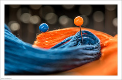 Orange And Blue 1/30 (John Penberthy LRPS) Tags: 105mm d750 johnpenberthy nikon blue bokeh closeup cotton macro macromondays orange pins silk skein yarn 130
