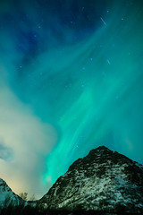 Picturesque Unique Nothern Lights Aurora Borealis Over Lofoten Islands in Nothern Part of Norway. Over the Polar Circle. (DmitryMorgan) Tags: norway arc astro astronomy auroraborealis beautiful cold colors famous fjord geomagnetic green illuminated intense ionosphere light lights lofoten luminosity magneticfield mysterious mystery nature night northern northernlights picturesque polarcircle sky solar spring stars sunactivity traveldestination unique vibrant vivid