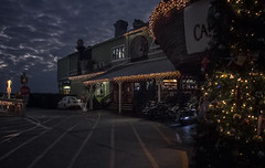 Dining on Charlotte Harbor (SteveFrazierPhotography.com) Tags: twilight evening puntagorda fishermensvillage beautiful shoreline lightschristmas decorations road roadway motorcycles stores shops clouds cloudy overcast dramatic stevefrazierphotography charlotteharbor peaceriver charlottecounty florida fl canoneos60d bar grill restaurant captainstable pub