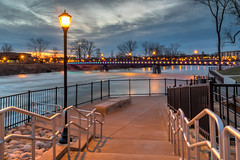 Step on down to the river (tquist24) Tags: hdr indiana mishawaka nikon nikond5300 stjosephriver bridge clouds evening fence footbridge geotagged lamp lamppost lights longexposure reflection reflections river rocks sky stairs starburst sunset tree trees water unitedstates