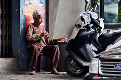 Quiet drink (Roving I) Tags: grannies greyhair elderly lifestyle drinks shops street doorways motorcycles footpaths cocacola signs ford plasticchairs bottles relaxation resting danang vertical vietnam