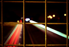 Metal Squares (108/365) (iratebadger) Tags: nikon nikond7100 d7100 moody nikonphotography tamron1024mm tamron fence metal squares traffic cars lighttrails red road a64 project365 perspective outside outdoors urban uk