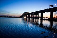 Sun sets on the Champlain bridge (KMo Foto) Tags: bridge sunset sky reflection water night river evening construction waves quebec montreal champlain ripples stlaurent saintlawrence