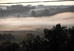 Atmospheric mystery  ,fog enveloping the valley   .Sunny mist  ?