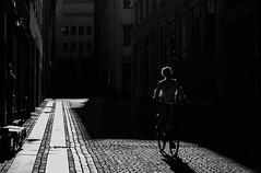 Light Rider (Olderhvit) Tags: bike göteborg alley sweden gothenburg streetphotography panasonic streetphoto skuggor cyklist gatufoto gx1 gatufotografi framingthestreet olderhvit p1100444 dmcgx1