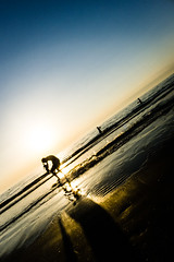 Skimboarding @ Zaandvoort Beach (vnkht) Tags: sunset sunlight black netherlands sunshine silhouette strand lumix evening raw dusk thenetherlands panasonic 24mm skimboarding zandvoort 2012 noordholland lightroom f63 nederlanden skimming northholland skimboarder iso80 zandvoortaanzee zandvoortbeach lx5 dmclx5 lightroom5 gavinkwhite