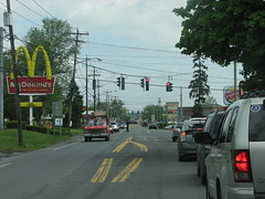 FAST FOOD ANYONE? (richie 59) Tags: road usa signs ny newyork trafficlights cars car retail america buildings outside us spring unitedstates fastfood greenport saturday oldbuildings headlights mcdonalds grill burgerking wires newyorkstate poles autos stores automobiles taillights nys back