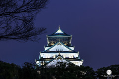 Osaka Castle at night in Japan (Jess Yu) Tags: city travel roof light sunset red sky orange moon color building tree tower castle beautiful beauty japan stone architecture night clouds dark evening twilight scenery colorful asia bright cloudy fort dusk traditional famous culture illumination dramatic peaceful landmark scene structure historic event area historical osaka moment oriental relaxation kansai kinki