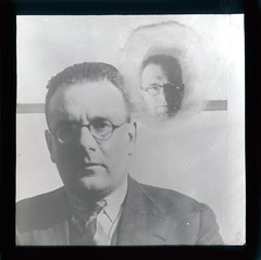 A Psychic Apparition (Tyne & Wear Archives & Museums) Tags: light blackandwhite man blur reflection face shirt strand mouth dark hair nose photography glasses weird scary eyes image spirit mark stripes space empty coat ghost grain captured experiment fake surreal tie ears eerie lips line creepy suit demonstration odd wash unknown mysterious unusual forehead lecture paranormal psychic blazer critical wrinkles shining spiritphotography bizarre surfaces 1934 fraud apparition forces distracted genuine supernatural ectoplasm cleanshaven investigation blankwall payment blankexpression collusion lanternslides anewangle makingeyecontact testconditions mrcpmaccarthy invitedcommittee 76clarkehouseroadsheffield