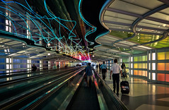 Concourse B to C (Anne Worner) Tags: people colors lines architecture lights neon curves peoplemover lightshow hdr travelers perspectiveanneworner