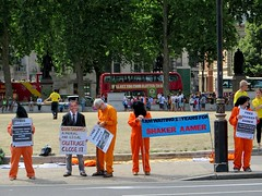 I am waiting 12 years for Shaker Aamer (Andy Worthington) Tags: london westminster squares politics protest streetphotography parliament parliamentsquare banners jumpsuits guantanamo placards sw1 hoods londonsquares politicalprotest andyworthington orangejumpsuits londonsw1 closeguantanamo boroughofwestminster shakeraamer saveshakeraamercampaign saveshakeraamer