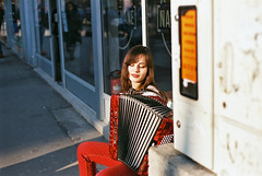 (Nothing is surrender) Tags: accordion girl woman streetphotography sun sunče red bless