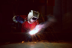Welding (Patrick Foto ;)) Tags: arc blue closeup construction craftsman engineering equipment fabricate fabrication factory fire flame flash gas hot industrial industry iron job labor laborer light man manual manufacture manufacturing mask metal metalwork protection protective repair safety skill skilled smoke spark sparks steel technical tool torch weld welded welder welding work worker working workplace