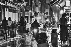 rainy night redux (albyn.davis) Tags: blackandwhite people silhouettes motorcycle street lights night wet rain weather cafes restaurants amsterdam netherlands travel jordaan