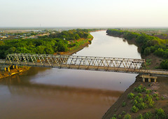 Aerial view of the metal bridge over Omo river, Omo Valley, Omorate, Ethiopia (Eric Lafforgue) Tags: above aerial aerialview africa architecture bridge colourpicture copyspace day developingcountry drone eastafrica ethdrone031758 ethiopia horizontal hornofafrica infrastructure kelem kurazworeda landscape loweromovalley metal metallic nature nopeople nobody omoriver omovalley omorate oromiya outdoors photography river riverbank steel tranquilscene traveldestinations trees water wild et
