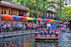 A Colorful View (amarilloladi) Tags: outdoors umbrellas cafes riverboats boats river water color sanantonioriverwalk riverwalk sanantonio texas