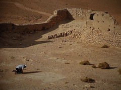 a devout man (SM Tham) Tags: africa morocco aitbenhaddou unescoworldheritagesite fortress fortifiedsettlement ruins walls ground man praying faith religion outdoor
