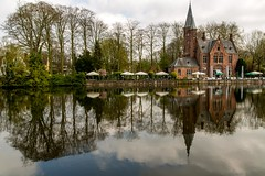 Beautiful Bruges, Belgium (Jill Clardy) Tags: 201704044b4a2803 bruges belgium loverslake lake water reflections tower trees outdoormuseum vintage history explore explored clouds cloudy day