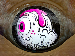 The Eye of the Buff Monster (Steve Taylor (Photography)) Tags: eye pupil buffmonster art digital graffiti sticker brown black mauve pink newzealand nz southisland canterbury christchurch cbd city distorted round