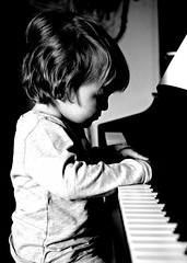 giacomo (brescia, italy) (bloodybee) Tags: 365project giacomo child little boy kid people piano music play keyboard bw lowkey portrait face profile