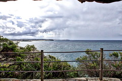 63+446: View from a cave (geemuses) Tags: manly nsw australia manlybeach sea sand surf waves water ocean landscape scenic scenery rocks cliffs view clouds sun cliff nature northernbeaches natural