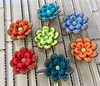 Zipper wrapped flower brooches (woolly  fabulous) Tags: recycled flowers zipper woollyfabulous pin brooch