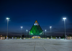 Palace Of Peace And Reconciliation By Night, Astana, Kazakhstan (Eric Lafforgue Photography) Tags: lighting people building green monument horizontal architecture night outside outdoors person vanishingpoint exterior nightshot pyramid streetlamps streetlights capital structure nightview centralasia kazakhstan kazakh modernarchitecture humanbeing sights easterneurope astana brianclarke streetlighting fosterandpartners palaceofpeaceandreconciliation akmola akmolinsk kz8268